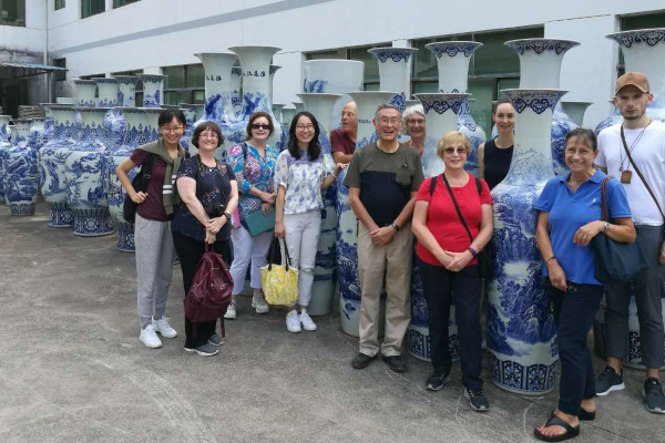 """""""<p><span style=""""color: #ff0000;""""><strong>A taste of Jingdezhen &ndash; Ceramics Capital of China</strong></span></p> <p><em>by Gillian Kew</em></p> <p>The first image that popped into my head when I started writing about this Friends tour was that of food! I know that it should have been ceramics, since we saw oodles and oodles of pots, jars, vases, and boxes; and enough dining, cooking, and drinking paraphernalia to sink the Titanic &ndash; again! Even the lamp-posts were covered in blue and white ceramics - an amazing sight for someone who was visiting Jingdezhen for the first time and had clearly not done her research! But for me, it was remembering the food that started my juices flowing. We always eat well on Friends tours but the food at every stop on this tour was superb; not fine dining, but fresh, clean, simply cooked, simply served, and plenty of it (too much in some instances).</p> <p>We even ate locally grown, organically produced vegetables after our tour of the Dongjiao Centre&rsquo;s organic farm in Jinkeng village. And this place was a real eye-opener. As well as farming, the Dongjiao Centre is also the recipient of an annual grant from the Sir Percival David Foundation Trust, in recognition of their work in preserving, protecting, and promoting Chinese ceramics.<span style=""""font-size: 8pt;""""><a href=""""#_ftn1"""" name=""""_ftnref1"""">[1]</a> </span>This small group of local enthusiasts was inspiring!</p> <p>Our main purpose, of course, was to experience china (or porcelain, if you prefer) from the Kaolin pits through to the Ancient kilns and more modern production methods in Jingdezhen, accompanied by our expert guide, Dr Guanyu Wang, a Postdoctoral Fellow at the CUHK Art Museum, who got us off to a good start with her revealing talk on the history of Jingdezhen&rsquo;s ceramics, and kept us &ldquo;topped up&rdquo; with nuggets of information as we visited different museums and sites. We also had a good local guide to provide more local information and to cor"""