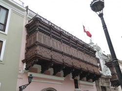 """ A fine example of the beautiful, ornate wooden balcony structures to be found in and around the main Plaza in Lima, Peru."""